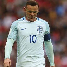 England captain Wayne Rooney apologises to the FA for 'inappropriate' pictures