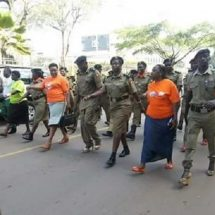 Police and men in Uganda participate in a walk to create awareness on Gender based violence.