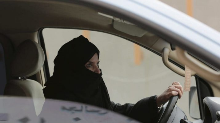 Aziza Yousef drives a car on a highway in Riyadh, Saudi Arabia, in 2014 as part of a campaign to defy Saudi Arabia's ban on female drivers. (Hasan Jamali/AP/file)