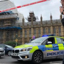 Car crashes into barrier outside UK parliament, man arrested, pedestrians injured